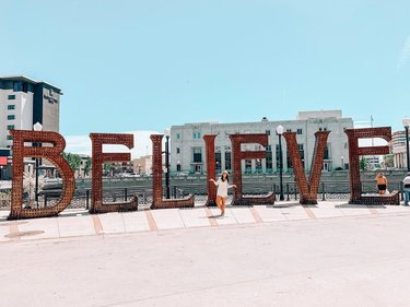 """Don't stop believing... hold onto that feeeeelingggg 🎼🎧 . Sometimes we all need a sign to keep on keeping on. Well this is that sign... it's rather large too 😂 . I've mentioned a few times that Reno is the gateway to Burning Man and because of that and our relationship with the arts, we often are graced with past installations being installed around the city. . This beauty is """"Believe"""" by Jeff Schomberg and Laura Kimpton and was on the playa in 2013."""