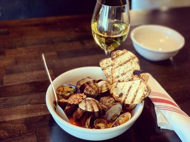 Whether it's an appetizer or an entree, our Basque Style Clams with garlic confit, @libertyexchange Basque chorizo and grilled ciabatta are a perfect pick! @luposomm wine pairing would be a vibrant and crisp glass of Tormaresca Chardonnay.  -  We are open Tuesday - Thursday 11:30 am until 8:00 pm and Friday - Saturday 11:30 am -8:30 pm for dine-in, takeout and curbside services. Give us a call or visit our website to make reservations.  We are now offering services through DoorDash!  -  Call: 775-461-0442 Online: CucinaLupo.com  -  #cucinalupo #carsoncity #localisbetter #downtowncarsoncity #foodie #clams #tormaresca #chardonnay #appetizer #entrée