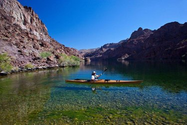 Photo of the day: Kayaking the Black Canyon Water Trail by Boulder City. It was 106º F when we got off the water, and water temps are right around 50º F. Great way to cool off, going into that water, and we were also able to keep our water jugs cold while we camped there for 2 nights. There are tons of hot springs and hiking available, and the water is clear and gorgeous. You can read about this and other kayaking in Nevada at: https://www.nevadamagazine.com/issue/july-august-2017/6625/ Photo by Jeremy Spilker. Posted by Art Director Kippy Spilker. #nvmag #nevada #coolingoff #kayaknevada #blackcanyonwatertrail