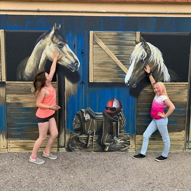 Took the girls to check out one of the cool new murals that popped up in Ely recently thanks to @jamievincek #morearteverywhere #horsingaround #visitelynevada #familyfun #mural #art #nevadaart #horses  #mountaintown #howtonevada @travelnevada @ponyexpressnevada @nvartscouncil