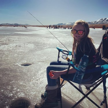 With colder temps and blue skies the #icefishing out here is looking good. Thanks arleigh_c for sharing this photo with us. #visitelynevada #familyfun #nvroadtrip #mountainlife #mountaintown #fishing #getoutside #greatoutdoors #howtonevada #photooftheday #