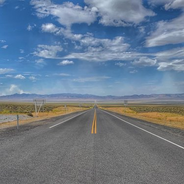 """We survived """"The Loneliest Road in America"""" —more commonly known as Highway 50—from Fernley to Ely across central Nevada.  AAA even advised against traveling the highway, claiming there was nothing to see. For those who were crazy enough to travel that lonely road anyway, they were advised to carry survival gear such as water and cold-weather clothes."""