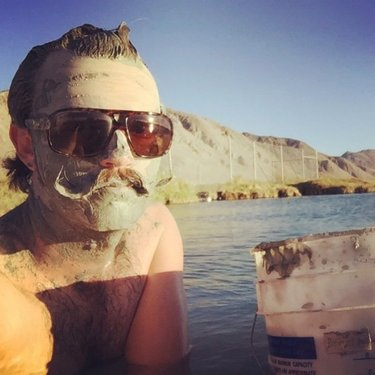 """You say """"mud bath,"""" we say """"one of the best au naturel Nevada-style spa experiences in the whole dang state!"""" 🧖🏻♀️♨️🤩 ••• Blast up the #BurnerByway and indulge in some """"me time"""" at a bevy of publicly accessible Black Rock Desert hot springs. These natural-bottomed pools are chock-full of nutrient-rich mud that would set you back a pretty penny at schmancy day spas, but out in the wild? Soak it up and slather it on! ••• Afterward, if you find yourself homebound and longing for that amazing soak sesh, treat yourself to the next best thing and order up some @blackrockmud, a skin-pleasing mud mask (and worldwide luxury spa staple) family-harvested from a private hot spring on the outskirts of Gerlach. Get into this and nine other badass #OnlyInNevada adventures at the link in our bio! . . . #TravelNevada #NVRoadTrip #HotSprings #NVHotSprings #AdventureSeekers #Geothermal #ExploreNevada #OutWest #NevadaLife"""