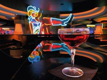 Bask in Vegas Vickie's neon glow over a signature cocktail.   #VegasVickies #CircaLasVegas #DTLV #Vegas