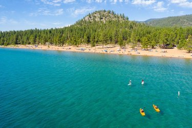 When on the south shore of #LakeTahoe, enjoy a day on #NevadaBeach & look for our #LTWT trailhead signage! Just 1 of 20 around the lake, you'll find launch/landing sites with wayfinding signage, parking and restrooms.  Need trip ideas? Click 👉 our profile link & check out all the day trips along the Lake Tahoe Water Trail. There's so many to pick from!  📸: sierra_business_council