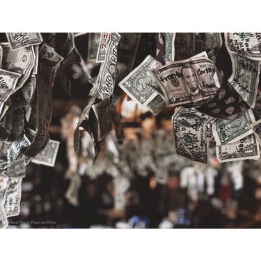 Money Money Money! 💰 💵  Pretty soon, Nevada history is about to be gone!  Camera: iPhone 7+  1/60 sec at f/2.8  ISO: 500  #moneymoneymoney #money #american #wildwildwest #bonniesprings #bonniespringsranch #nevada #nevadahistory #bar #tavern #shotoniphone #apple #iphoneportraitmode #kodachrome #filmphotography #fivedollars #onedollar #lasvegas #lasvegasphotographer #vegasphotographer #vegasweekend #chaching #farewell #farewelloldfriend #moodygrams #iphonographer #iphonography #bestofiphone