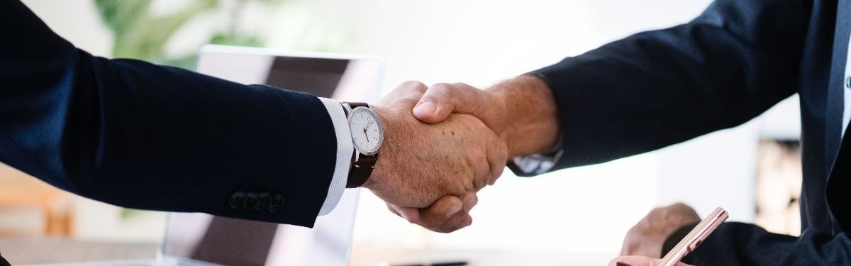 Photo of employers shaking hands.