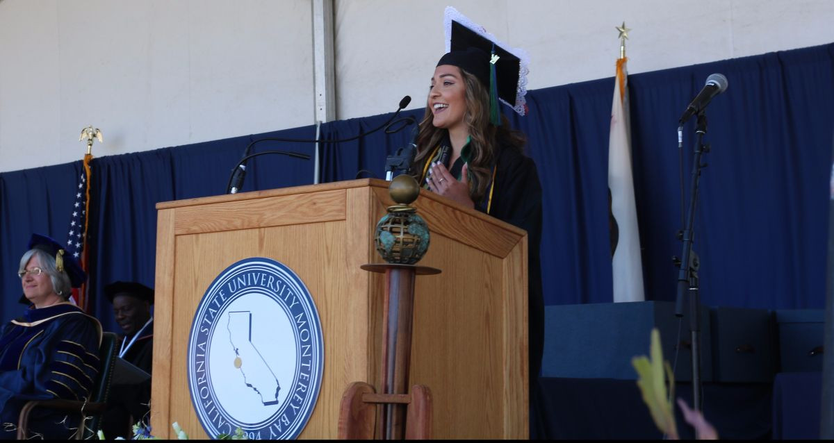 Student speaking at a podium.