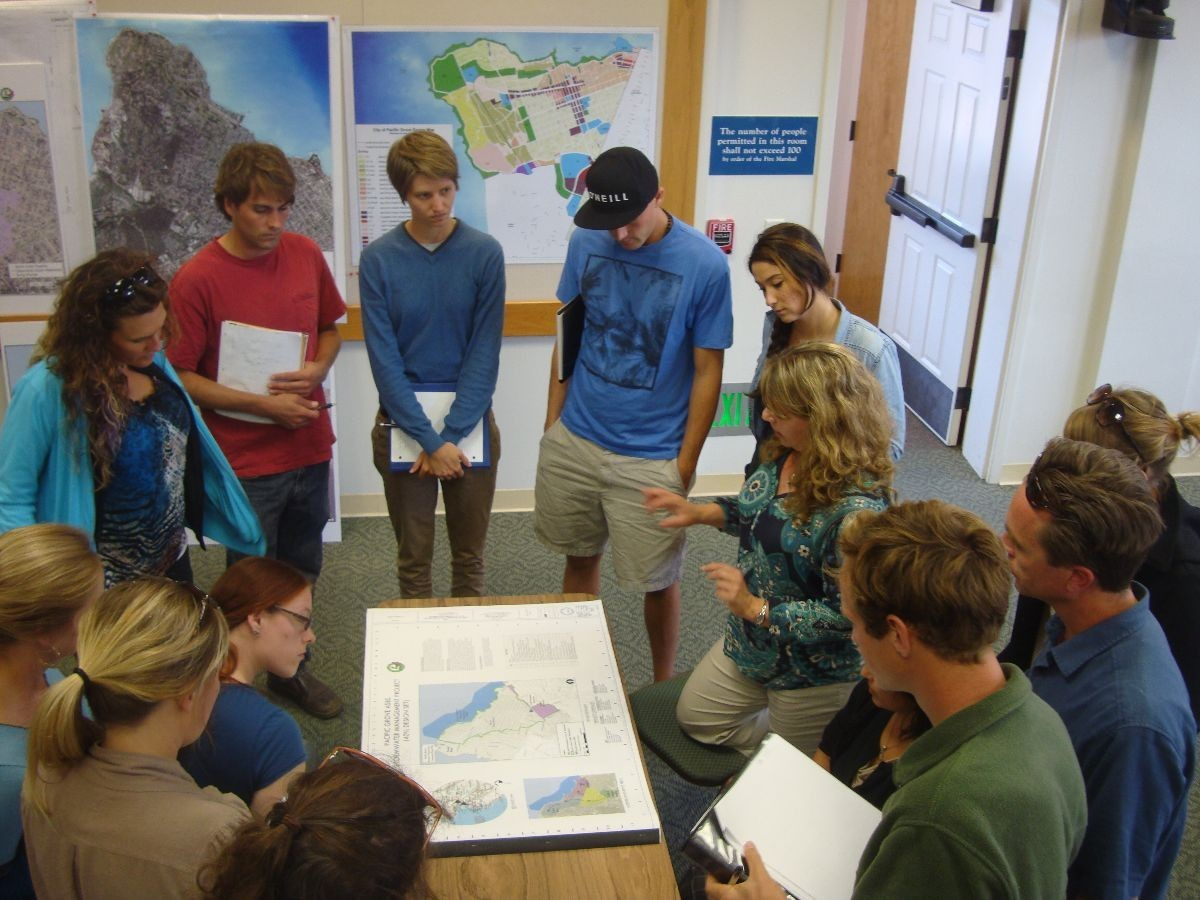 AMWS students gathered around map