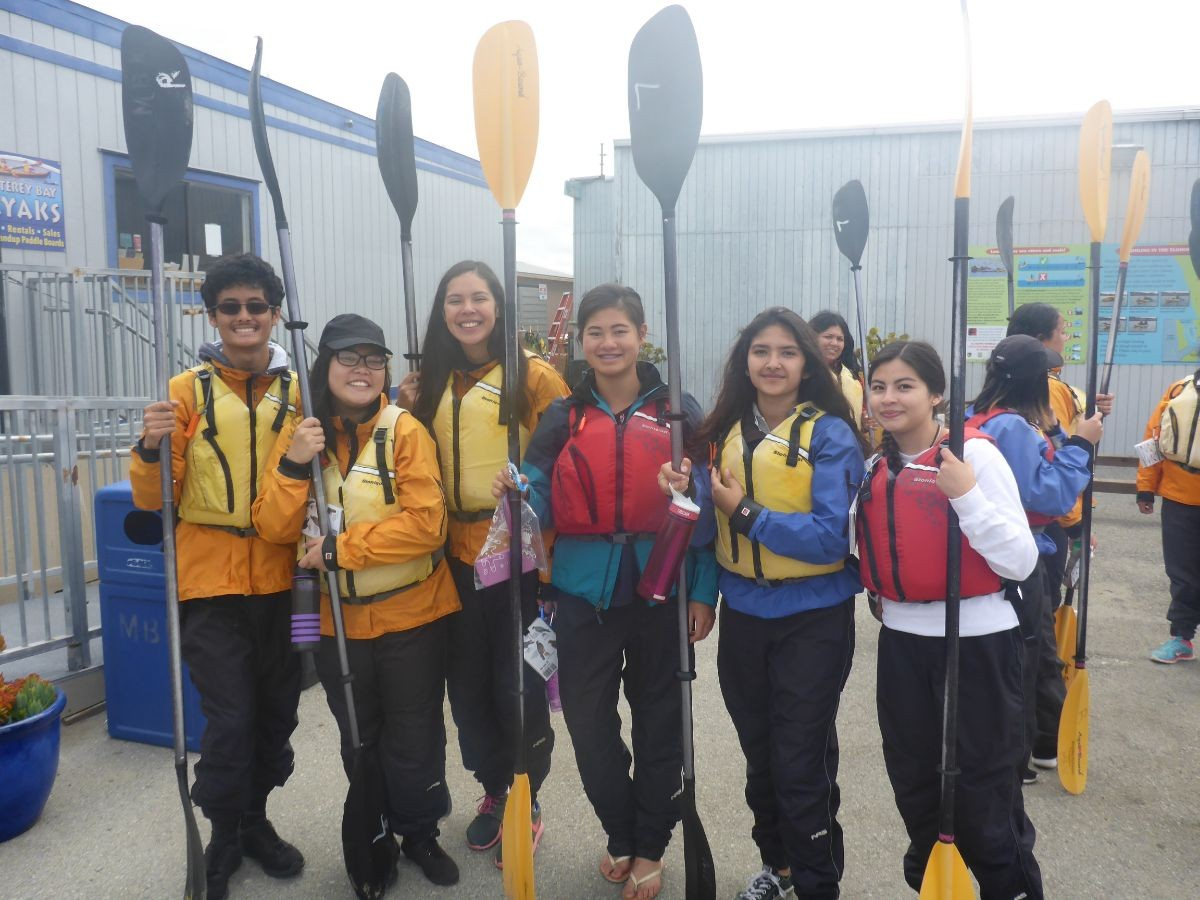 RISE students getting reading to kayak during Summer Program