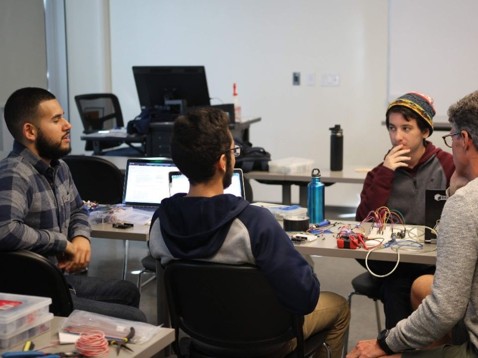 Hackathon team works together on their project.