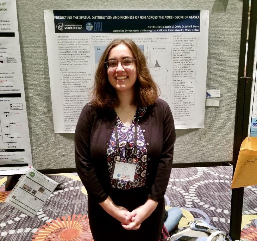 Arev in front of her research poster