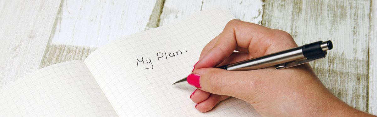 "Photo of female writing down the words ""My Plan"" in notebook."