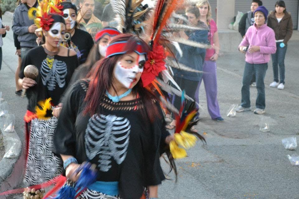 Aztec dancers lead the procession