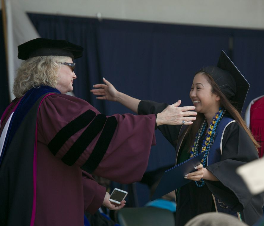 Faculty member and student during 2016 commencement ceremony.