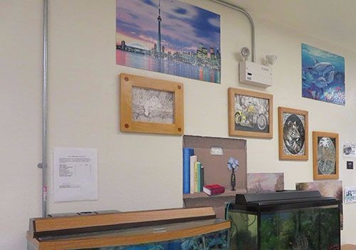 Art made by an inmate decorates the wall of a prison hospice unit.