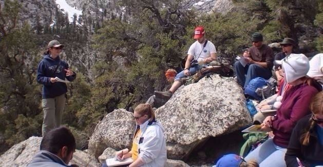 Students sitting on rocks in outdoor course