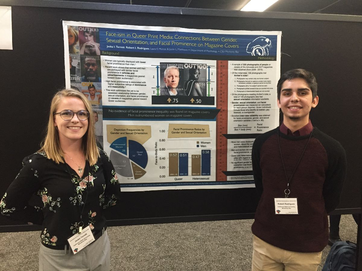 Student researchers presenting at a conference.