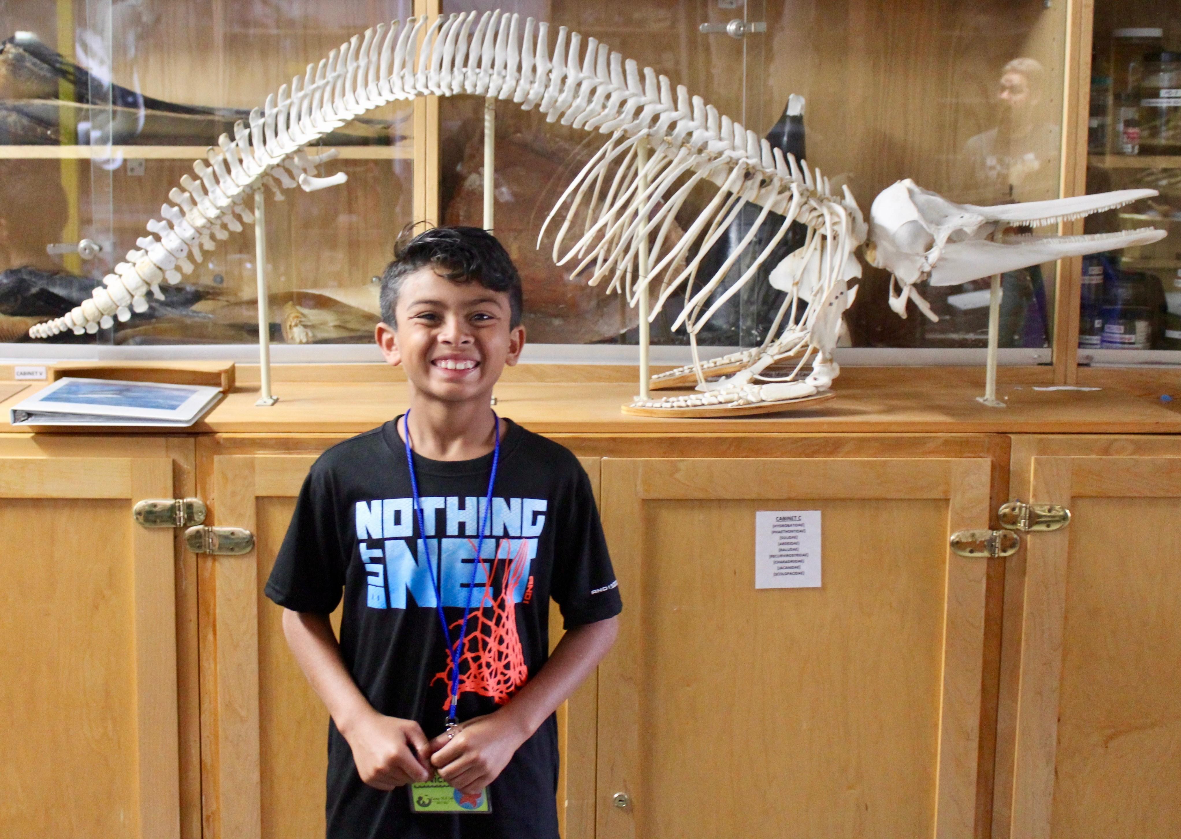 Boy posing with skeleton
