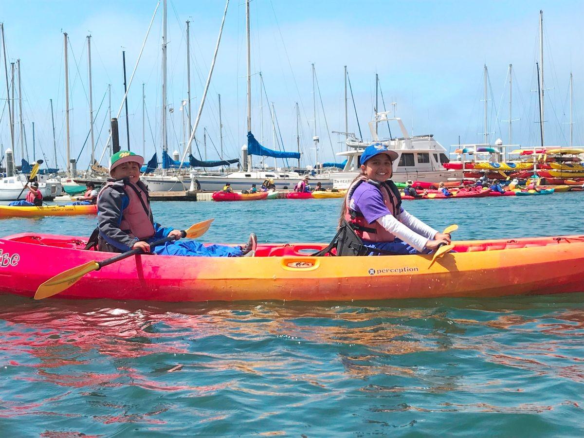 two campers kayaking
