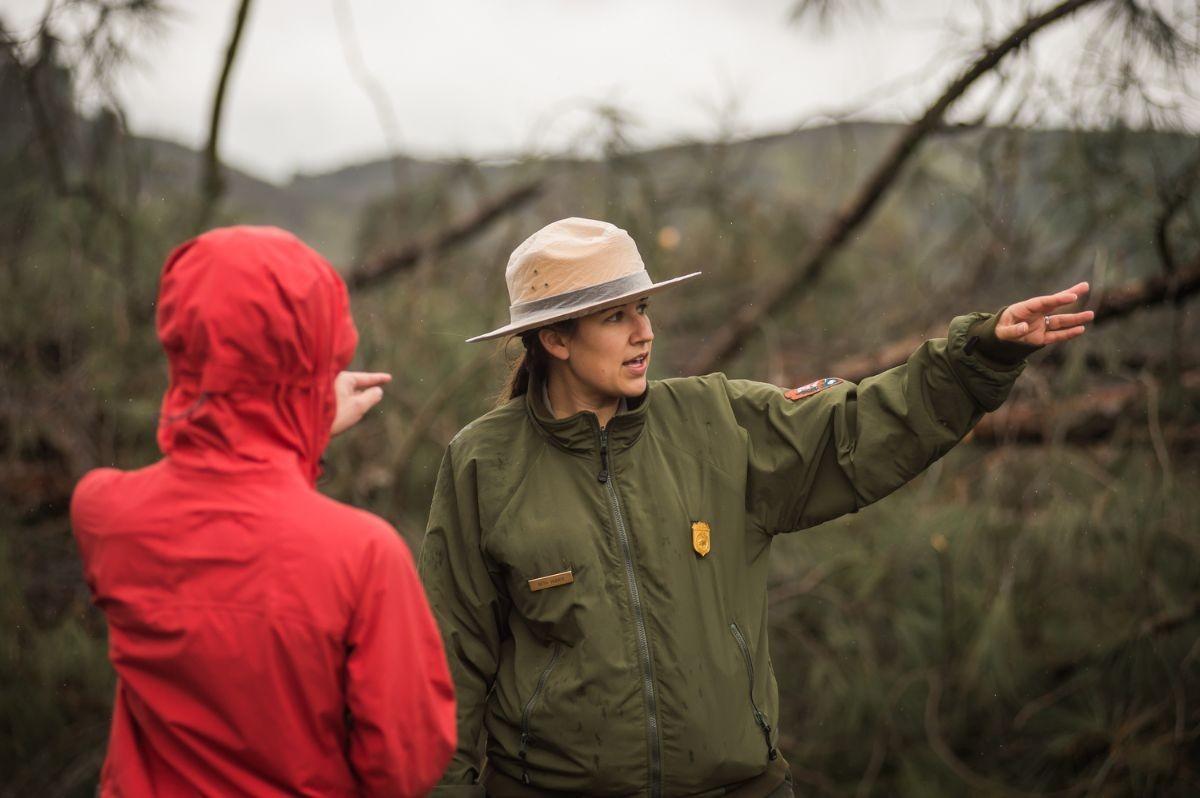 Range Elizabeth Hudick speaks to a guest at Pinnacles National Park.