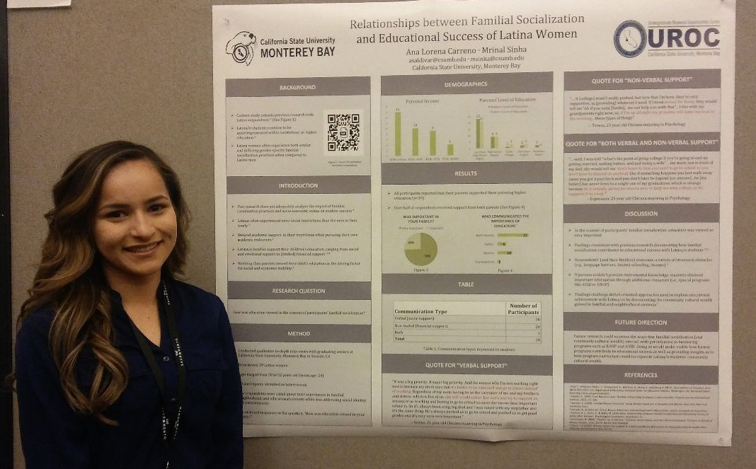 Student researcher presenting at a conference.