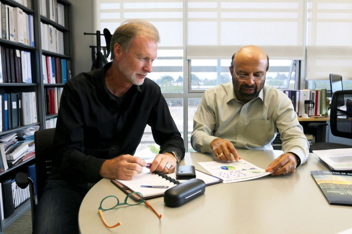 Brad Barbeau and Shyam Kamath discussing the institute's success.