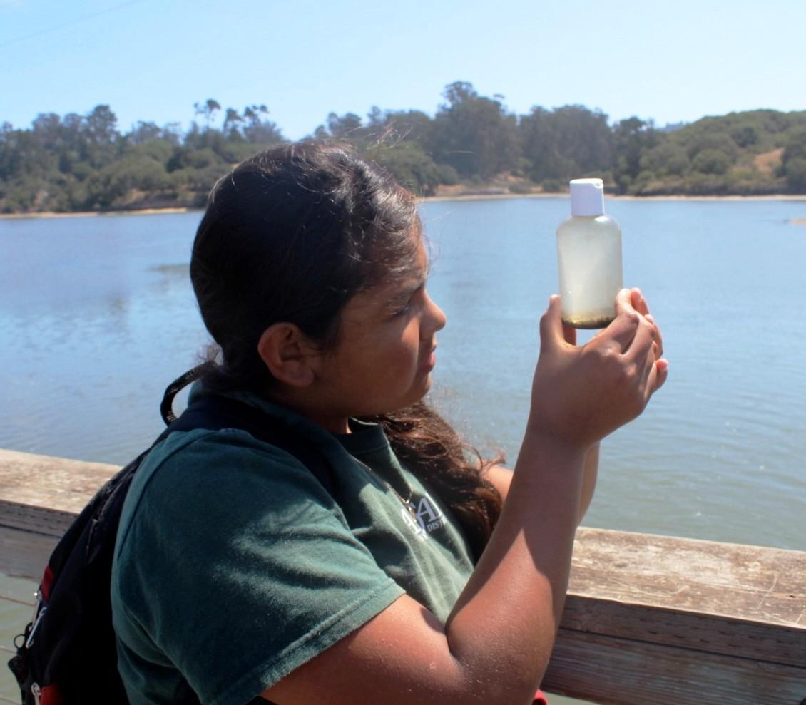 camper looking at plankton