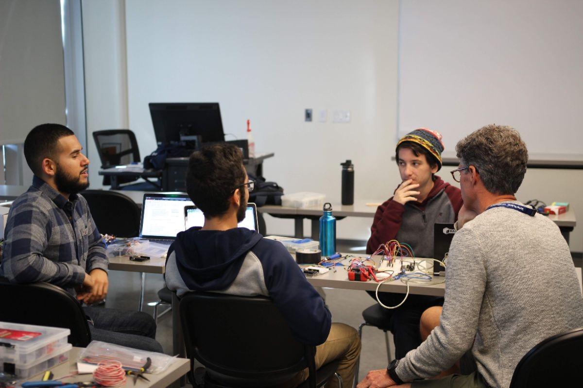 Team works together on Hackathon project.