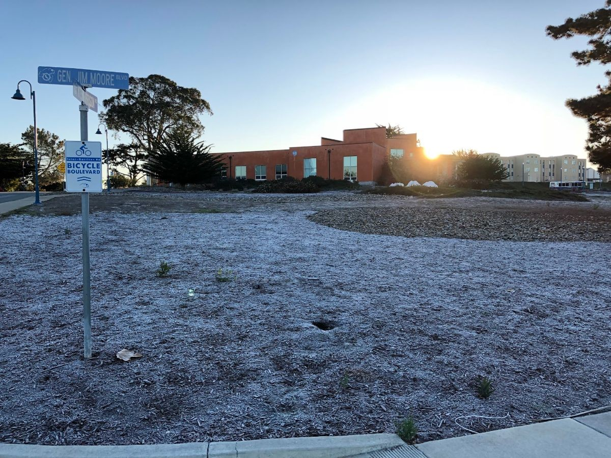 frost covering the ground in front of a building