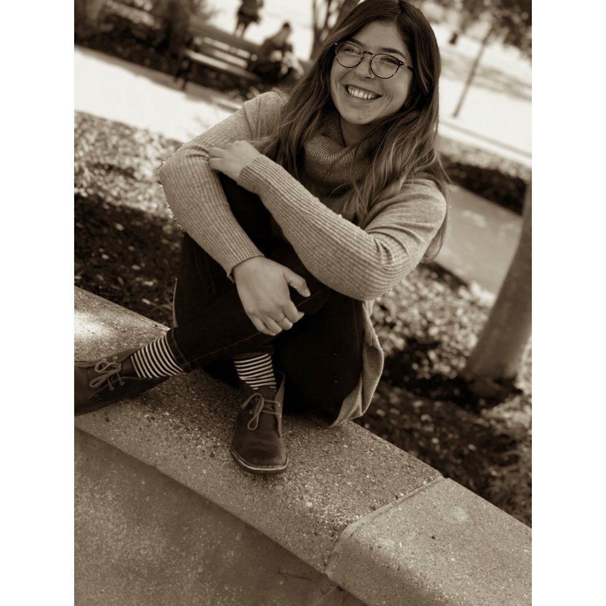 Student Lorean Alvarez sitting in a pose