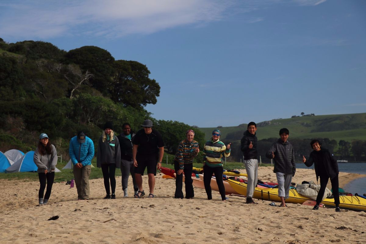 Participants get ready for an activity on the beach at the Leadership Expeditio