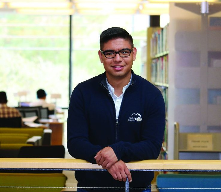 Student poses in library