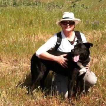 Dr. Arlene Haffa hiking with her dog