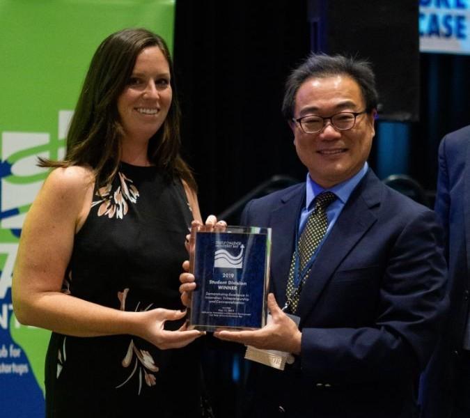 Photo: Student winner of 2019 Startup Challenge with Eric Tao