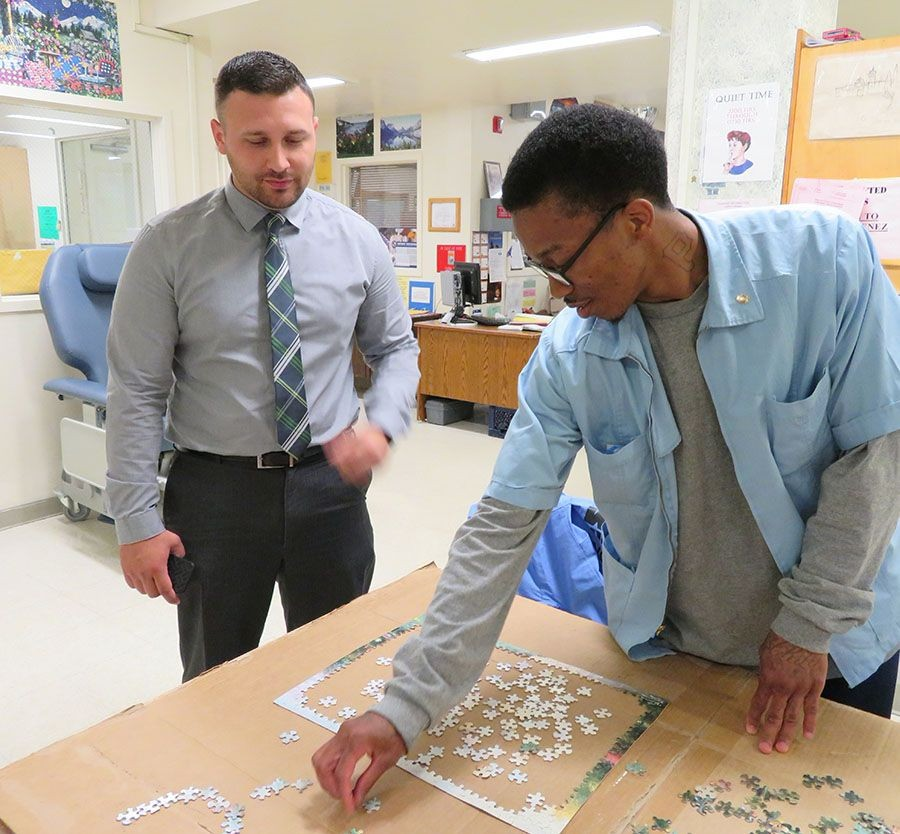Kevion Lyman, PCS worker at CMF's hospice unit works on a puzzle.
