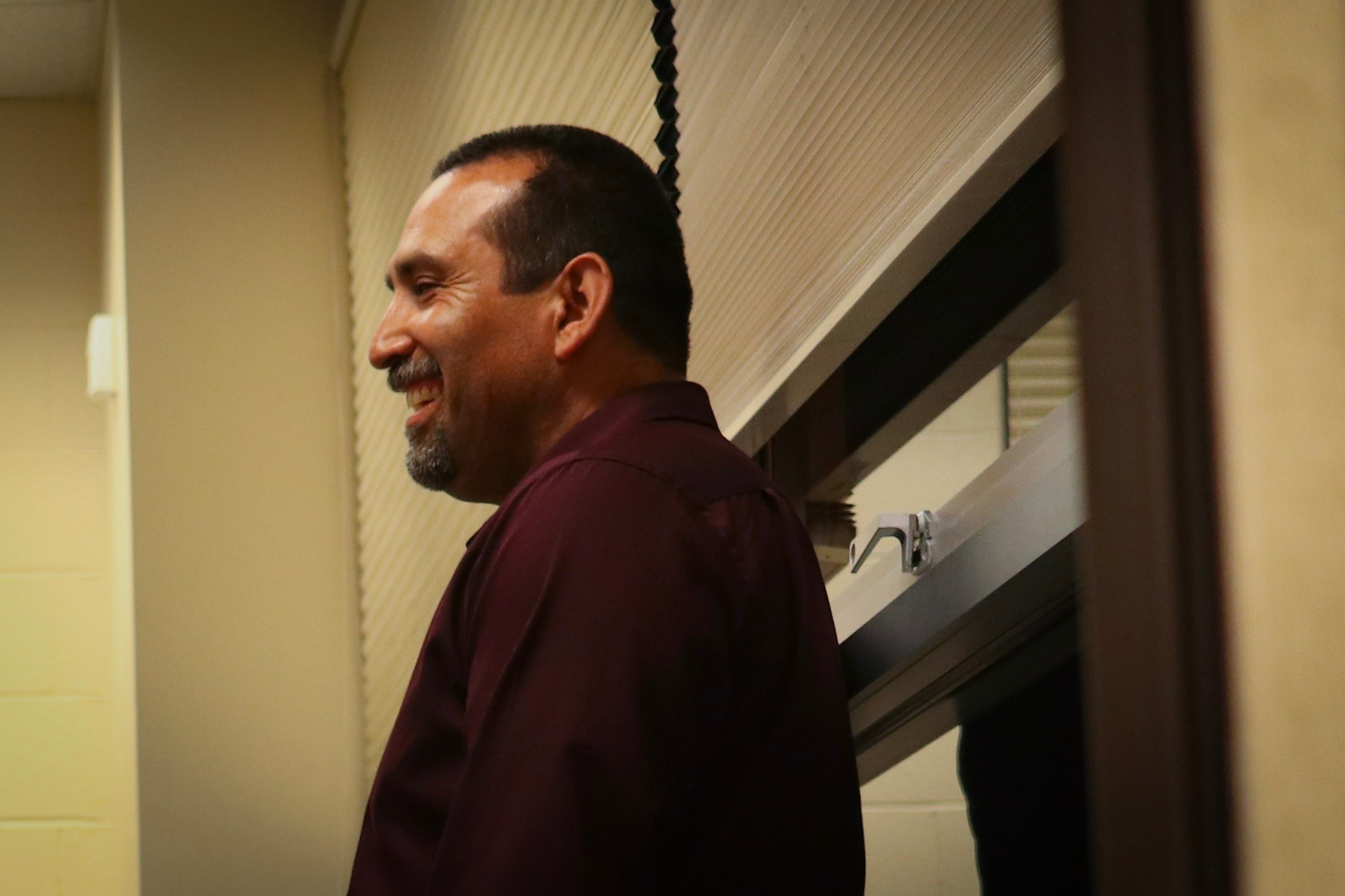 Ricky Cadriel smiles and laughs while talking with students.