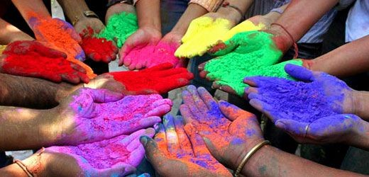 hands covered in the holi festival powder