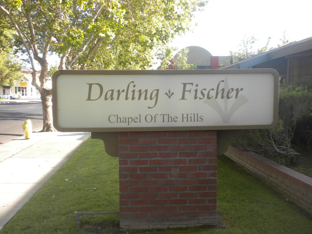Darling  Fischer Chapel of the Hills Sign