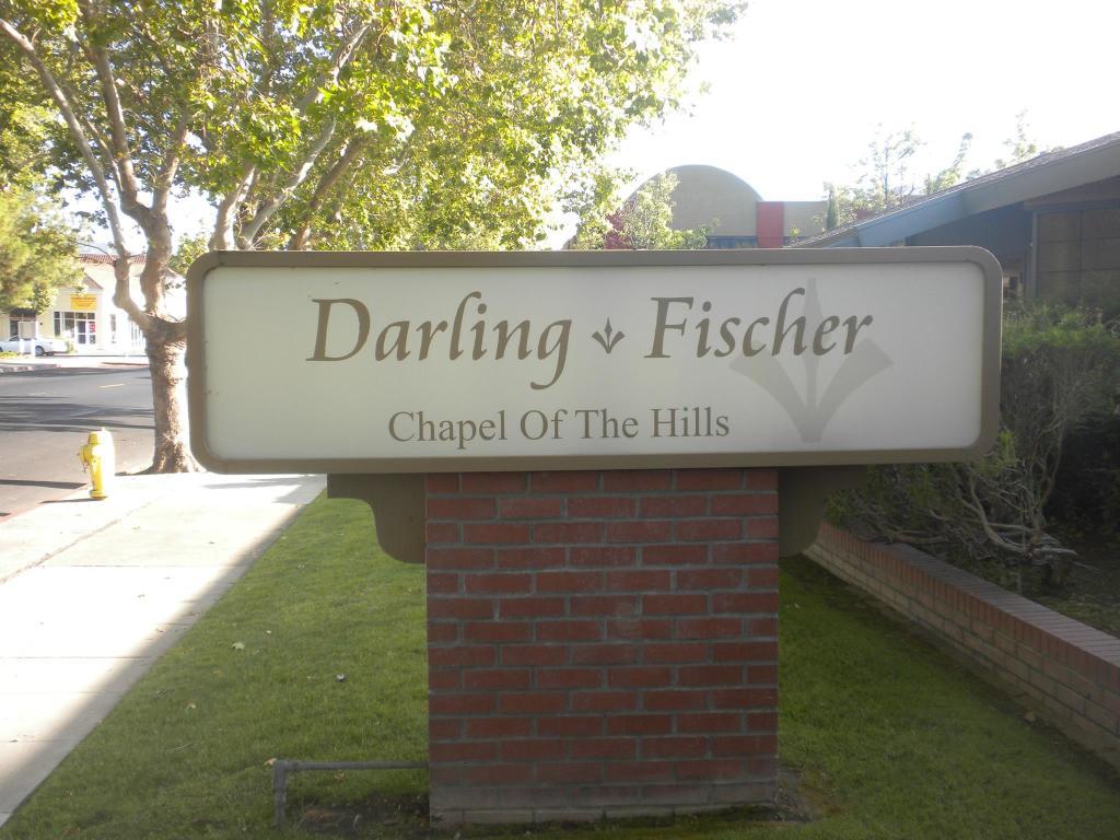 Darling  Fischer Chapel of the Hills Sign