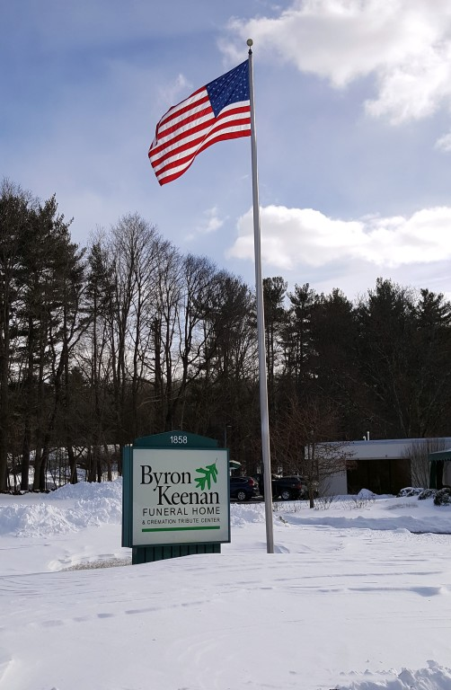 Byron Keenan Funeral Home  Cremation Tribute Center Sign and Flag