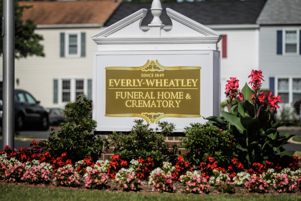 Beautiful blooming Begonias in front of the Everly-Wheatley sign.