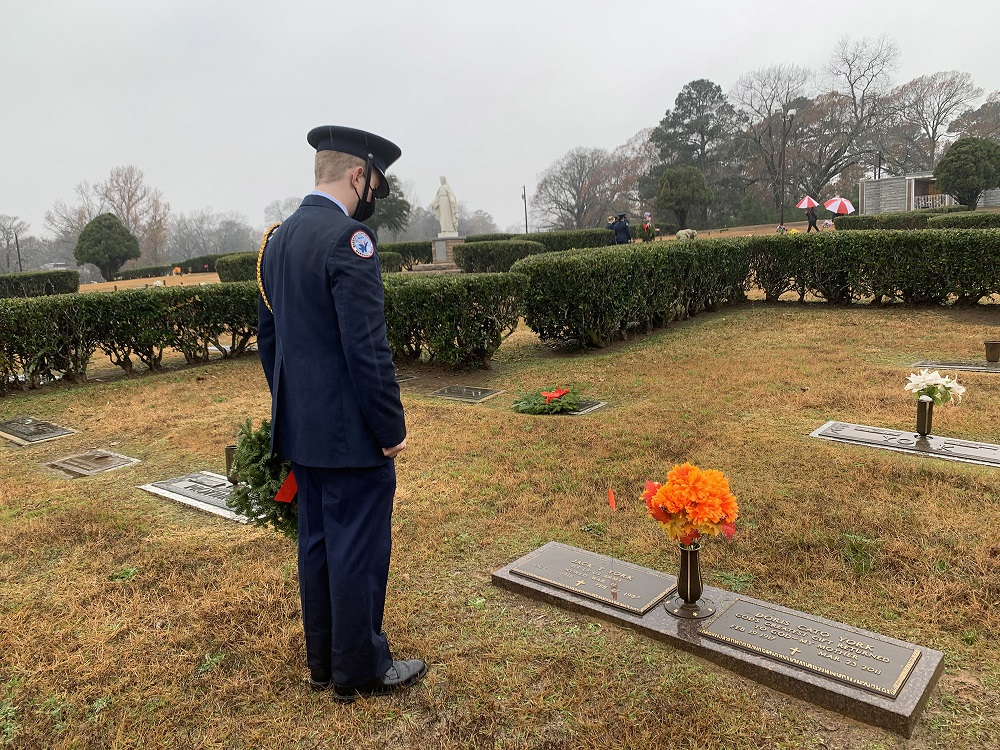 JrROTC Cadet pauses before placing wreath to honor a veteran at Wreaths Across America Ceremony
