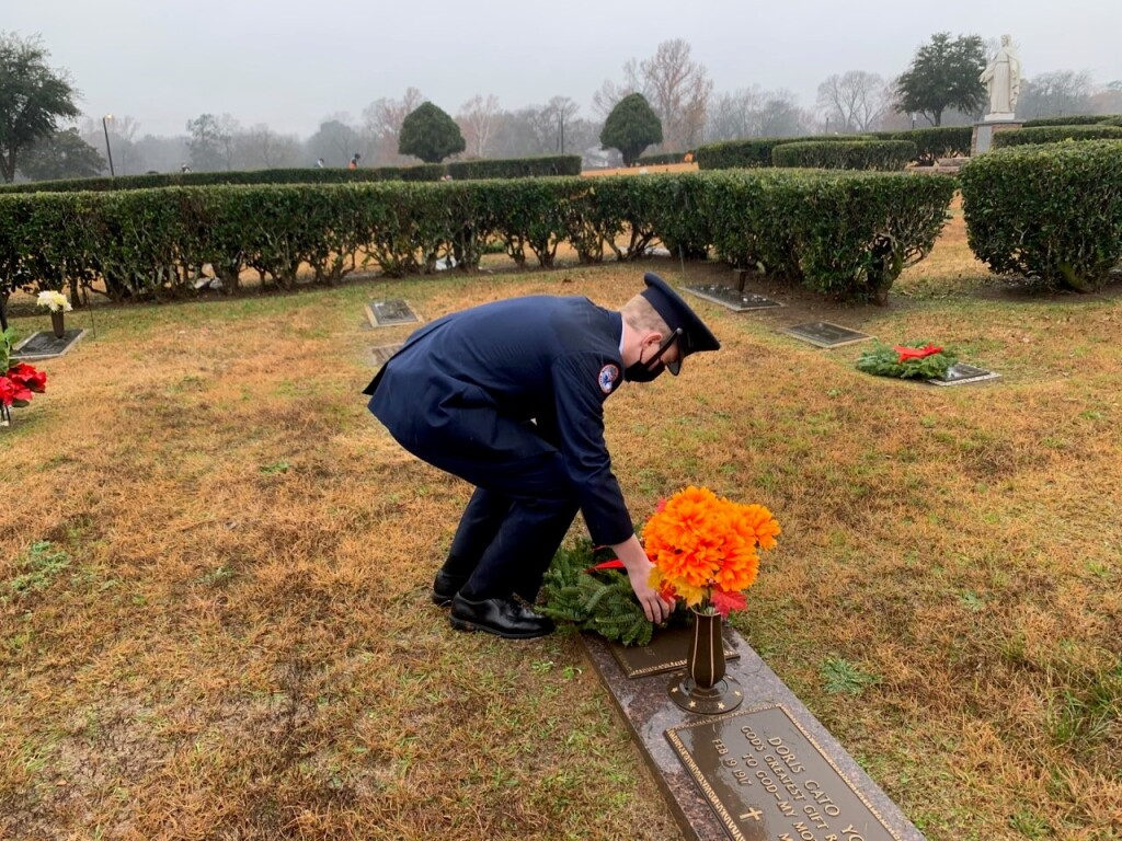 JrROTC Cadet places wreath on Veterans grave at Wreaths Across America Ceremony
