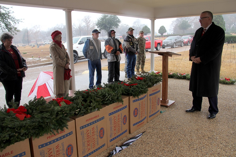 Robert Coleman, Managing Partner of Sullivan Funeral Home and Cemeteries leads the Wreaths Across America Ceremony at Algoma Cemetery on December 19, 2020