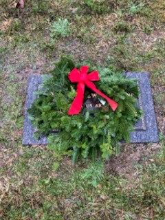 Wreath placed on a Veterans Memorial at Algoma Cemetery