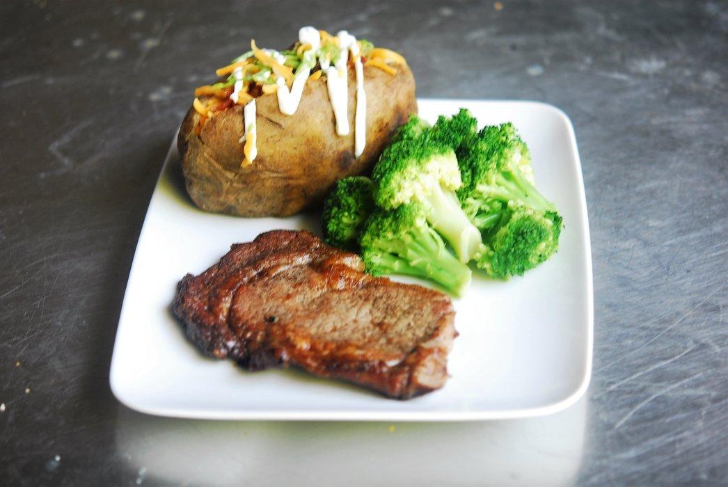 Classic Delmonico Ribeye with Loaded Baked Potato