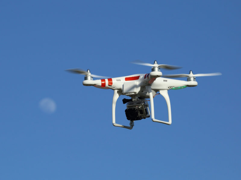 The DJI Phantom is a popular drone capable of carrying a camera.