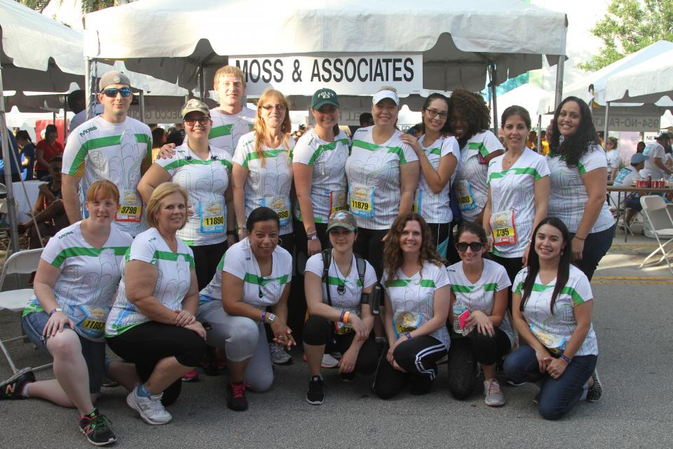 Moss sponsored runners pose for a team photo in the 2016 Mercedes-Benz Corporate Run in Fort Lauderdale.