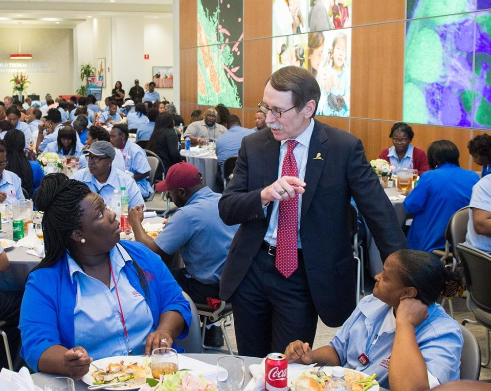 President and CEO Dr. James Downing greets employees at the annual Environmental Services Appreciation Dinner.